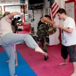 Kicks demonstrating kickboxing