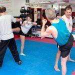 Twin kicks in kickboxing class