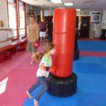 Martial arts Class Heavy Bag Kicking
