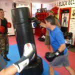 Karate Class Punching Bag Instructor