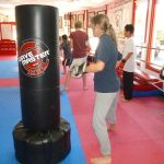 Martial arts Class Punching the Heavy Bag