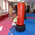Martial arts Class Heavy Bag Kicking