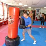 Karate Instructor Punching the Bag